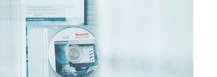 Stack of Rexroth documentation CDs and user manuals, for Packaging and processing