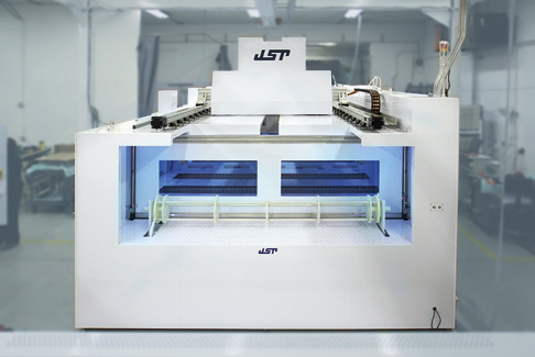 Wet bench cleaning station made by JST Manufacturing treats silicon chunks so that they attain 99.99 percent purity.
