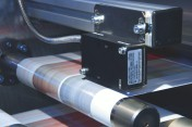 The integrated register control reduces paper waste by preventing register shifting.