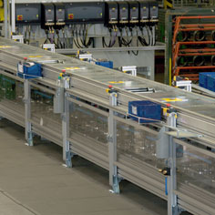 Covers and enclosures on the TS 5 conveyor sector protect the workspaces.